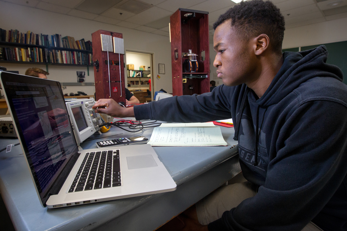 student at computer, physics