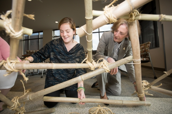 Appalachian Studies Graduate Student, Kelsey Wagner and Dean Melba Spooner of the College of Education building a Geodesic Dome. Photo Marie Freeman.
