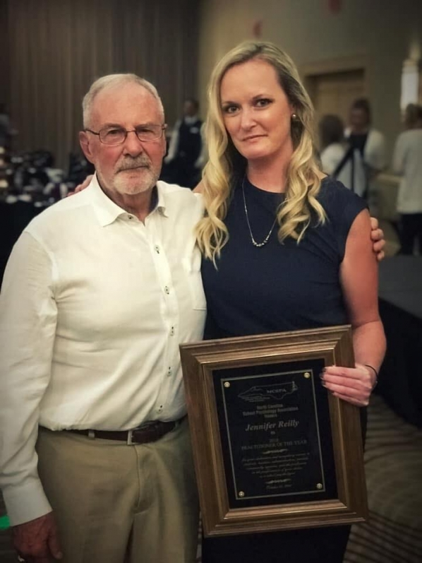 Jenny Reilly receiving the practitioner of the year award, and Dr. Jim Deni who received the liftetime achievement award.