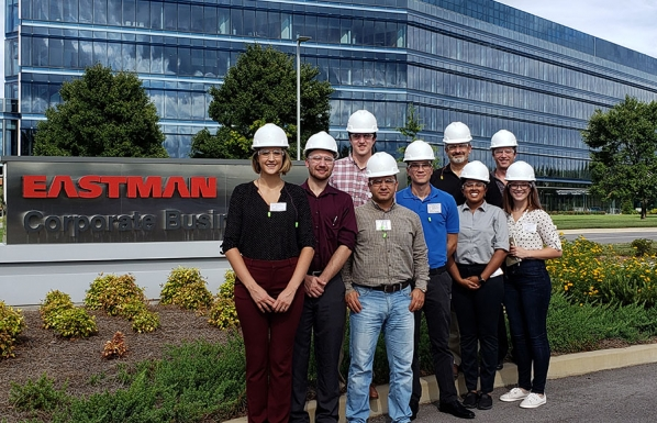 The HR Science Research Team visits Eastman Chemical Co.'s facility in Kingsport, Tennessee, in September 2018 to meet with their project collaborators. The team also toured the facility, hard hats and all, allowing them to meet the people who carry out and are affected by safety protocol and gain a better understanding of the conditions in which they work. Pictured, from left to right in the front row, are IOHRM graduate students Lauren Ferber '16 and Matthew Laske; Dr. Yalçin Açikgöz, assistant professor