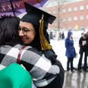 After the morning ceremony, graduating Appalachian State University senior Razan Farhan Alaqil embraces Traci Royster, director of staff development and strategic initiatives for Appalachian's Division of Student Affairs, outside of the Holmes Convocation Center. Photo by Chase Reynolds