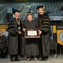 Alma Marsh (center), receives an honorary bachelor's degree from Dr. Neva Specht (left) and Chancellor Sheri Everts (right), as Chair of Appalachian's Board of Trustees, James M. Barnes, looks on. Photo by Marie Freeman