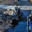 Student scientists and instructors test the water quality in Boone Creek, a waterway that travels through Appalachian's main campus. Plans to daylight the creek are part of a larger resiliency initiative. Photo by Marie Freeman