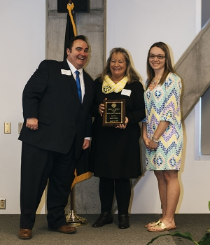 Dr. Jonathon Hyde, dean of students and associate vice chancellor for student affairs, left, poses with Rhonda Brooks Bullock, center, and Celine Bullock, daughter and granddaughter, respectively, of Ronnie L. Brooks, for whom the Ronny L. Brooks Award for Outstanding Leadership is named. Sarah Aldridge, who was not in attendance at the Leadership and Legacy awards ceremony, is the 2018 recipient of the award. Photo by Jeremiah Bradshaw