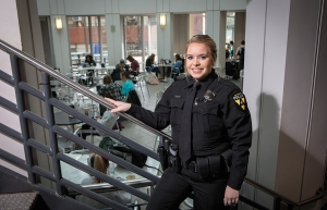 Bryce Helms, a senior criminal justice major and full-time Appalachian police officer, takes a pause from her duties for a photo in the university's Plemmons Student Union. Photo by Marie Freeman