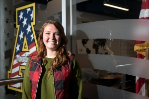 Junior Becca Ryan, age 26, outside Appalachian's Major General Edward M. Reeder Jr. Student Veteran Resource Center. She took some classes through Coastal Carolina Community College while working at Camp Lejeune, and then enrolled at Appalachian. Photo by Marie Freeman