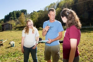 Dr. Tom Whyte talks with anthropology majors Amanda Neumeyer of Hendersonville and Emma Jones of Reidsville at an archaeology experiment site in Fall 2016. Only 10 percent of archaeology is digging, he tells students – the rest is making meaning of what is found. Photo by Marie Freeman