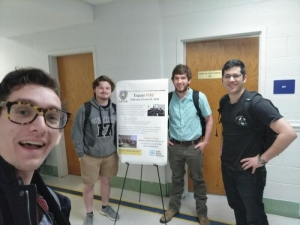 Department of Computer Science staff member and students pictured left to right: Michael Dougherty (coach), students Dylan Beasley, Jackson Sippe and Andrew Thorp