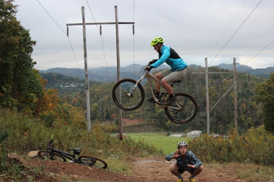 Ben Dannemiller on bike, jumping over a friend during his time at Appalachian. Photo submitted