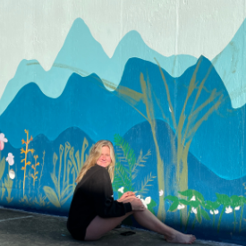 Mary Carver Deal painting the mural outside of Appalachian Brian Estates. Photo submitted.