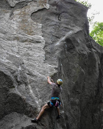 Photo of Carpenter rock climbing during his time at Appalachian. Photo submitted