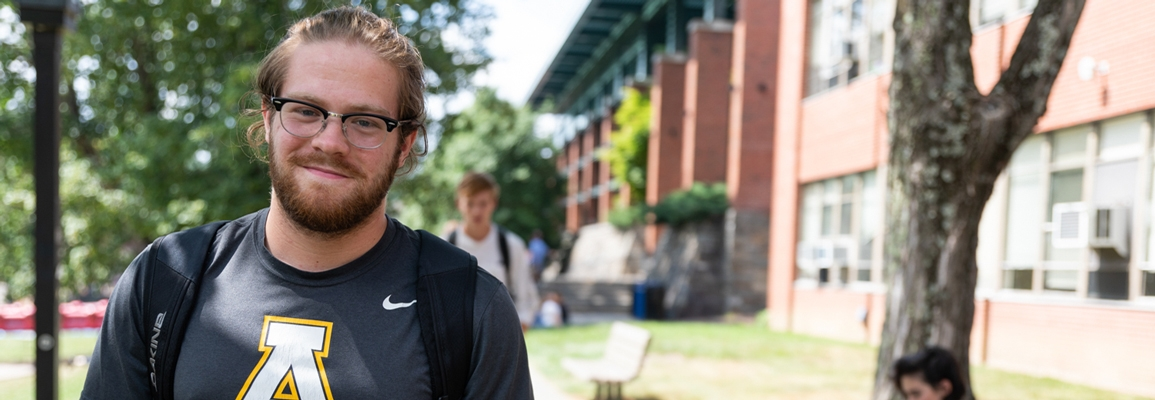 App State student in front of LS Dougherty home to the Department of Languages, Literatures and Cultures