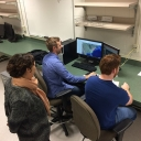 Dr. Jessica Mitchell, assistant professor in Appalachian's Department of Geography and Planning, oversees Appalachian undergraduate students Darek Olsen, left, and Shane Sosko as they test an online interactive map for visualizing project datasets. Photo courtesy of Jessica Mitchell