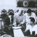 "Richard Buckminster ""Bucky"" Fuller, center, instructs students in an architecture class at Black Mountain College. Fuller — an architect, author, educator, inventor and engineer — taught at Black Mountain College in the summers of 1948 and 1949. Photo courtesy of Western Regional Archives"
