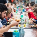 Hundreds of members from the Appalachian and local communities enjoy a sustainable meal of salad, baked potatoes and apple pie during the 2018 Community FEaST held on Appalachian's Sanford Mall. The event is designed to bring people from all walks of life together to engage in conversations about the importance of a sustainable food system for all. Photo by Marie Freeman
