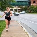 Olivia Bargoil, a junior industrial design major from Clayton, jogs along Rivers Street, which bisects Appalachian State University's campus in Boone. Outdoor exercise, such as jogging, allows individuals to both enjoy the High Country's many recreation opportunities and remain active during COVID-19, according to Appalachian faculty experts and University Recreation staff. Face coverings are not required while outside as long as the appropriate 6 feet of physical distance can be maintained. Photo by Chase