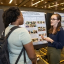 Graduating senior Annie Klyce, from Atlanta, right, who is majoring in geology, presents her poster during the Joint Oceanographic Institutions for Deep Earth Sampling (JOIDES) exhibit at Appalachian's 2019 STEAM Expo. Photo by Ellen Gwin Burnette