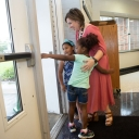 National Board Certified Teacher Dr. Amie Snow '06 '14, director of curriculum and instruction at the Appalachian State University Academy at Middle Fork, greets two young students as they enter the school for Open House Aug. 22. Snow is a two-time graduate of Appalachian and her NBCT credential includes a generalist/middle childhood certification. She holds an M.A. in reading education with a general graduate teaching certificate and a doctorate in educational leadership. Photo by Marie Freeman