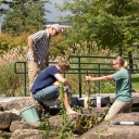 Dr. Shea Tuberty, professor in and assistant chair of Appalachian's Department of Biology, far left, works with biology graduate students Grant Buckner, of Burnsville, center, and Cristina Sanders, of Taylorsville, to collect water samples from Boone Creek. Their water quality studies are among the many campus research and creative endeavors that address issues or concerns within the High Country area, benefitting the region while providing students with skills that are sought after from both employers and