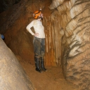 Dr. Sarah Carmichael looks for manganese oxide coatings on speleothems in Worley's Cave in Tennessee. Carmichael, associate professor of geology at Appalachian, will be received as a Fellow in The Explorers Club in New York City, March 24. Photo courtesy of Sarah Carmichael