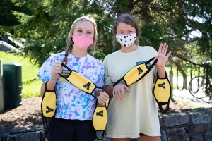During fall 2020, Appalachian State University students developed and supported peer accountability programs to encourage members of the Appalachian Community to comply with safety precautions related to COVID-19. Pictured are Wellness Ambassadors Melina Tirrell, left, a sophomore social work major from Pineville, and Jessica Phillips, a sophomore finance and banking major from Charlotte, handing out face coverings. Photo by Chase Reynolds