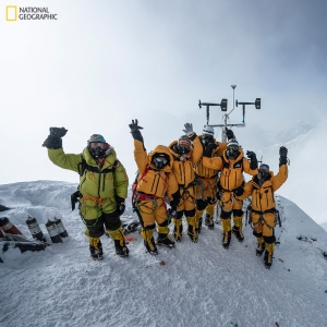 At 8,430 meters above sea level, the high-altitude expedition team celebrates after setting up the world's highest operating automated weather station during the 2019 National Geographic and Rolex Perpetual Planet Everest Expedition. Learn more at www.natgeo.com/everest. Photo by Mark Fisher, National Geographic.