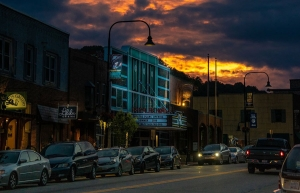 Lights illuminate the facade of the Appalachian Theatre of the High Country as the sun sets over downtown Boone. App State faculty, staff and students across the university have contributed toward the reopening of the renovated Appalachian Theatre in Boone, which will take place Monday, Oct. 14. Photo by Leslie Rostivo