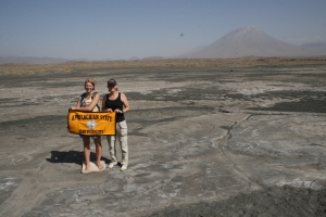 Katelyn McGinnis '11, left, and Dr. Cynthia M. Liutkus-Pierce, a professor in the Department of Geological and Environmental Sciences, hold the Appalachian State University flag at the footprint site in Tanzania. Six undergraduate students participated in research activities related to this study, for which a culminating article has been published in the journal Scientific Reports. Photo submitted