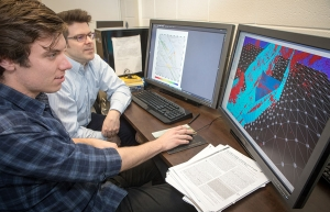 Appalachian alumnus Jake Dorsett '18, left, and his research mentor, Dr. Scott Marshall, professor in the Department of Geological and Environmental Sciences (GES), view their three-dimensional model of faults and earthquake locations in California's Imperial Valley. Photo by Marie Freeman