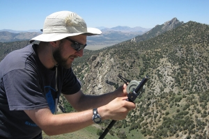 Dr. Cole Edwards, assistant professor in Appalachian State University's Department of Geological and Environmental Sciences, takes measurements of sedimentary rocks in Nevada. Photo submitted