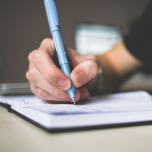 Image of person writing. Stock image for the Creative Writing Scholarship Competition fall 2019.