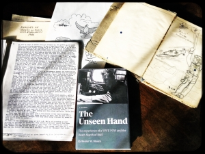 """""""The Unseen Hand"""" book cover alongside Bealer Moore's sketchbook and memoir. Photo submitted."""