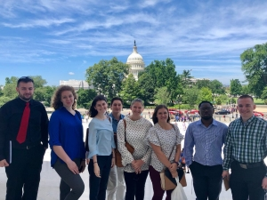 """(Left to right) Students Daniel Frye, Ashely Tauscher, Annah Seaford, Brian Bauk, Darby Adams, Amber Layfield, Travian Smith, Aaron Pura on the Department of Government and Justice Studies """"Justice in D.C."""" Study Away trip in summer 2019. Photo submitted by Aaron Pura."""