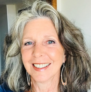 Kit Gruelle '12, Sociology, is a survivor of domestic violence who has worked as an advocate for battered women and their children for 33 years. She is the College of Arts and Sciences Outstanding Alumni Award winner for 2020-21. Image provided.