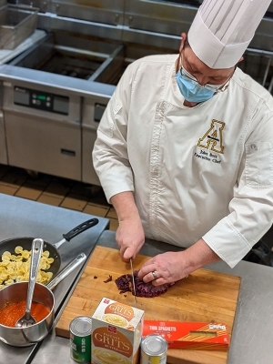 Jules Bott, executive chef in Appalachian State University's Campus Dining, preps food for one of the meals offered through App State's Meals for Mountaineers program. The meals will be available for pickup on weekdays by students, faculty and staff Dec. 11–Jan. 14, 2021. Photo by Rachel Butts
