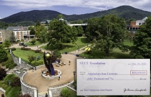 This aerial photo of Appalachian State University campus shows an inset image (bottom right) of the $50,000 grant check awarded to App State by the North Carolina State Employees' Credit Union (SECU) Foundation. This funding will support App State's implementation of the foundation's Rural Opportunity Grant program — a pilot initiative designed to support public nonprofits in the state's Northwest, Northeast and Sandhills regions. App State will serve as the program's anchor institution for the Northwest No