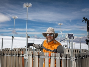 Perry, a professor in Appalachian State University's Department of Geography and Planning, is pictured working in high-altitude gear at the weather station he installed on the Quelccaya Ice Cap in Peru in 2018. Photo by Marie Freeman. Right photo submitted