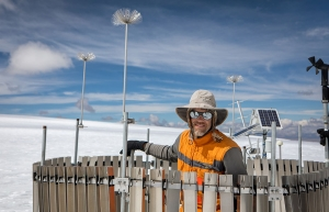 Dr. Baker Perry, graduate program director and professor in Appalachian's Department of Geography and Planning, works at the weather station he installed on the Quelccaya Ice Cap in Peru. The station sends data directly to his lab in Boone. Photo by Marie Freeman