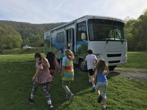 """An excited group of third graders participating in the """"Water on the Move"""" program run towards the Appalachian Department of Geological and Environmental Sciences Geobago for the hands on lab activities. Photo by Marta Toran"""