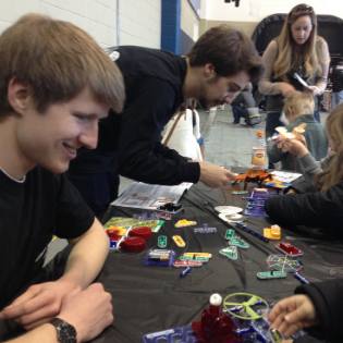 PandA members Jacob Harris and Jack Griffin teach circuit building to elementary school students. Photo submitted.